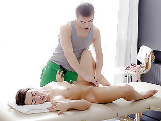 Ira moans with pleasure as her male masseuse rubs her sweet ass.