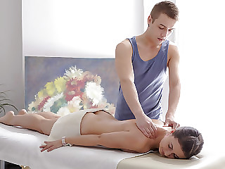 The masseuse gets ready to work on Maia's young body before they try anal